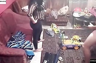 Spy camera records couple fucking in the living room.