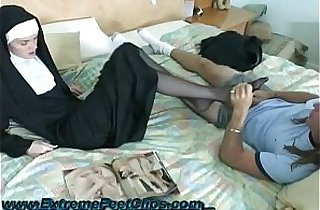 Nun giving a Footjob