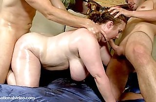 MILF is Oiled and Fucked by Muscle Bound Studs