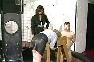 Horny slave in leather skirt got spanked on her nice ass by mistress